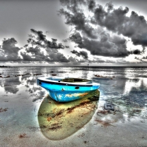 photograhic composition of boat on the ocean
